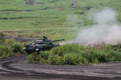 Modern military tank firing its main gun Stock Photography