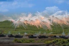 Modern military tanks firing defensive counter-measures Stock Photos