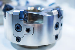 Modern milling cutter with indexable inserts. Shallow depth of field Stock Photo