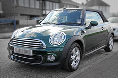 Modern mini coupe convertible car. Photo of a modern mini coupe convertible car parked by kerb Stock Images