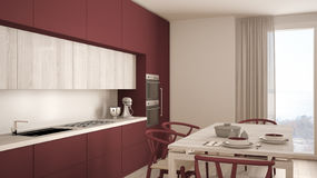 Modern minimal red kitchen with wooden floor, classic interior d Stock Image