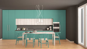 Modern minimal turquoise kitchen with wooden floor, classic inte Stock Images