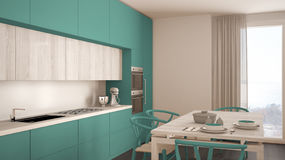 Modern minimal turquoise kitchen with wooden floor, classic inte Stock Photo