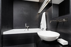 Modern minimalism style bathroom. Interior in black and white tones Royalty Free Stock Photo