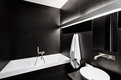 Modern minimalism style bathroom interior in black Royalty Free Stock Image