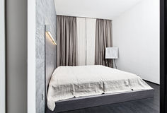 Modern minimalism style bedroom interior Royalty Free Stock Photos