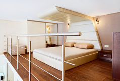 Modern minimalism style bedroom interior in beige Royalty Free Stock Image