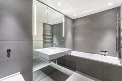 Modern minimalist bathroom in gray and white Royalty Free Stock Photography