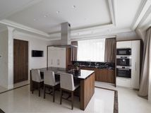 Modern minimalist kitchen with dining room Stock Images