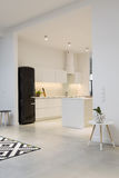 Modern minimalist kitchen in spacious house Royalty Free Stock Images