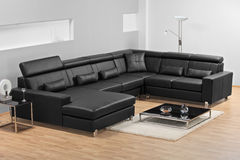 A modern minimalist living-room with leather sofa Stock Photos