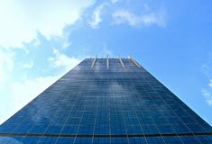 Modern mirror office building against blue sky background stock images