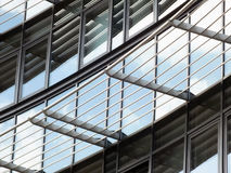 Modern mirrored glass building  with curved windows Royalty Free Stock Photography
