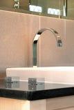 Modern mixer bathroom taps Stock Photos