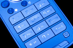 Modern mobile. A mobile phone blue keyboard Royalty Free Stock Photography