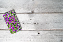Modern mobile device showing violet flowers Royalty Free Stock Images