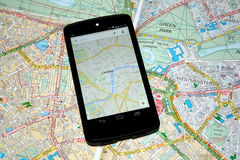 Modern Mobile Maps vs Traditional Paper Maps for Navigation. This picture shows you a modern mobile version of London street map on the screen of a mobile device royalty free stock photo