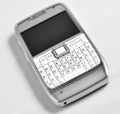 Modern mobile phone. This photograph represent a modern mobile phone, aluminium casing, full qwerty Royalty Free Stock Images