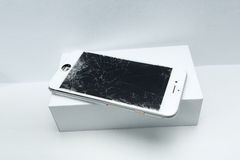 Modern mobile phone with broken screen on white background Stock Photos