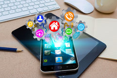 Modern mobile phone with cogwheels icons Stock Photos