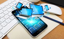 Modern mobile phone connecting tech devices Stock Photography