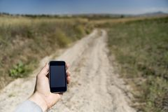 Modern mobile phone in the countryside Stock Image