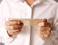 Modern mobile phone in the hand Royalty Free Stock Photos