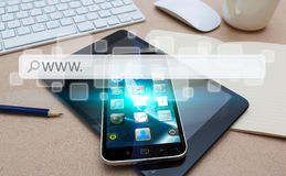 Modern mobile phone with internet web bar. Modern mobile phone in office with web bar flying over Stock Photos