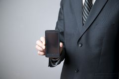 Modern mobile phone in male hand Royalty Free Stock Photos
