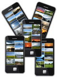 Modern mobile phone with many photo of landscapes Royalty Free Stock Photography