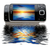 Modern mobile phone with a nice seacape with water Royalty Free Stock Photos