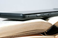 Modern mobile phone on old yellow book pages close up stock photography