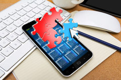 Modern mobile phone with puzzle icons Royalty Free Stock Photo