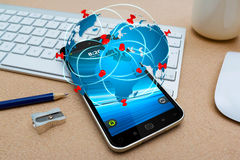 Modern mobile phone with travel icon application Stock Photography