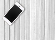Modern mobile phone on white wooden Stock Image