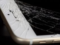 Broken Cell Phone on Black Background royalty free stock image