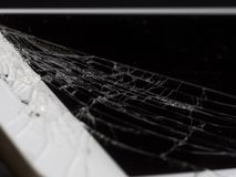 Broken Cell Phone on Black Background stock images