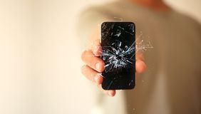 Modern mobile smartphone broken screen and damages. Cellphone cr. Ashed and scratch. Device destroyed. need repair royalty free stock photos