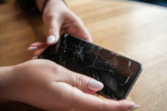 Modern mobile smartphone broken screen and damages. Modern mobile smartphone broken screen and damages royalty free stock image