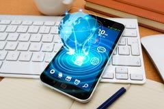Modern mobiltelefon med cybervärlden Royaltyfria Bilder