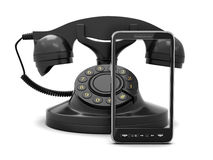 Modern mobiltelefon och retro roterande telefon Royaltyfria Bilder
