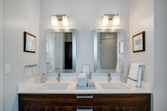 Modern modern bathroom at hotel resort. New modern bathroom sink and mirrors of upscale hotel resort Royalty Free Stock Photography