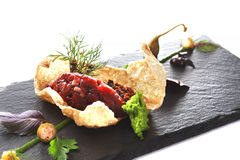 Modern Molecular cuisine. Molecular modern cuisine. Chips Pigskin with tartare or carpaccio of beef. Stock image. Isolated on white Stock Photo