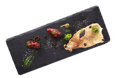 Modern Molecular cuisine. Molecular modern cuisine. Chips Pigskin with tartare or carpaccio of beef. Stock image.  on white Royalty Free Stock Images