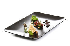Modern Molecular cuisine. Molecular modern cuisine. Chips Pigskin with tartare or carpaccio of beef. Stock image.  on white Stock Photography