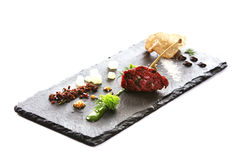 Modern Molecular cuisine. Molecular modern cuisine. Chips Pigskin with tartare or carpaccio of beef. Stock image.  on white Royalty Free Stock Image
