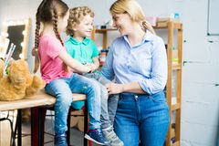 Modern Mom with Two Cute Kids royalty free stock photo