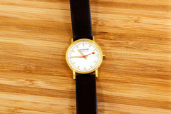 Modern Mondaine precision swiss watch on wooden bacground Royalty Free Stock Photos