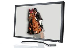 Modern monitor with horse jumping out Stock Photo