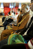 Modern monk. Picture of modern monk with modern gadgets like cell phone and ipad royalty free stock photos